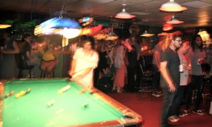 Trung Ngo, of TV Girl, shooting pool before their set